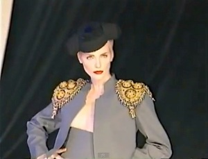 runway video still, Givenchy by John Galliano FW1996 ready-to-wear grey suit with black montera and gold matador epaulettes
