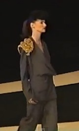 runway video still, Givenchy by John Galliano FW1996 ready-to-wear flannel jumpsuit with gold matador epaulette