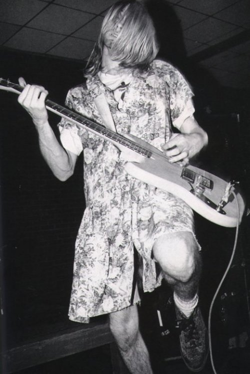 Kurt Cobain performs in a vintage floral print, Amherst, 1990