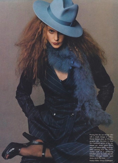 Nicole Kidman in Anna Sui pinstripe suit, sequinned cami, with hat and faux stole, photographed by Steven Meisel Vogue February 1995