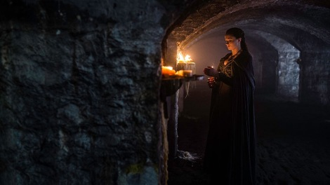 "Sansa lights candles in the Stark crypt at Winterfell in ""Sons of the Harpy"" - Game of Thrones s5 e4"