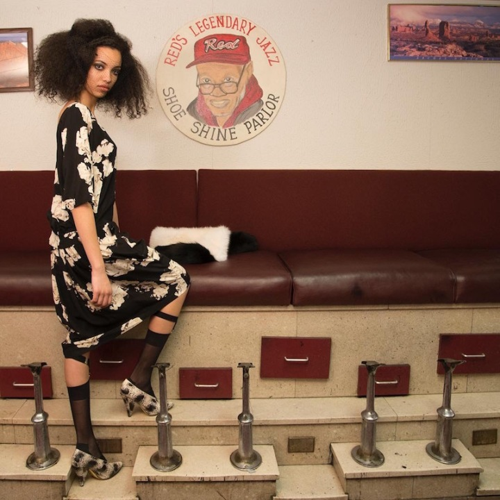Catherine Nako wears a Tracy Reese dress at Red's Jazz Shoe Shine Parlor, Detroit. Photo: Ray Rushing