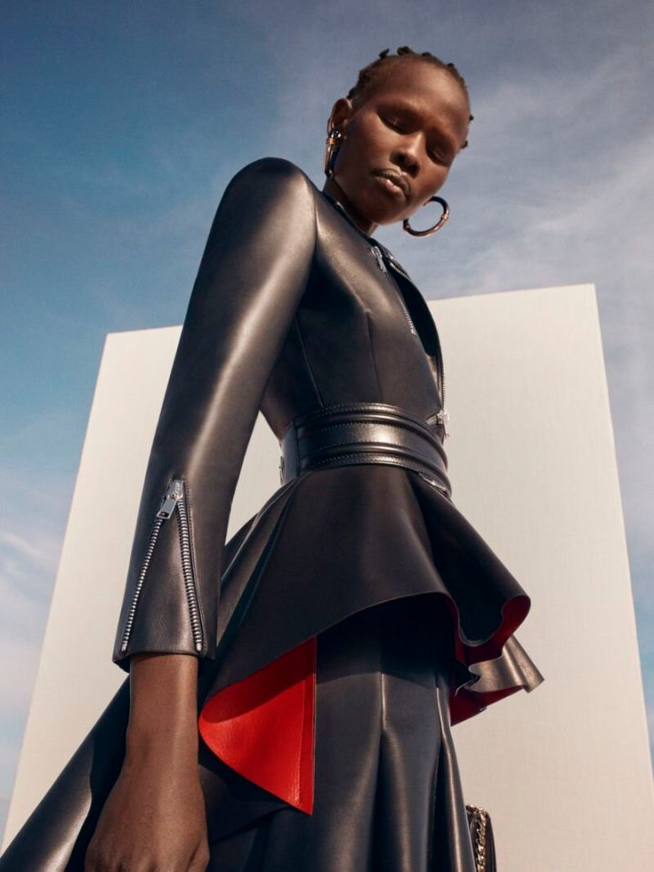 Shanelle Nyasiase photographed by Chloé Le Drezen in a black leather jacket and skirt - Alexander McQueen Resort 2020